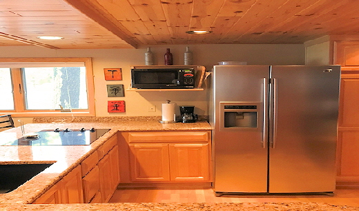Lake Front Cabin Eleven Large Granite Kitchen with Glass Cooktop